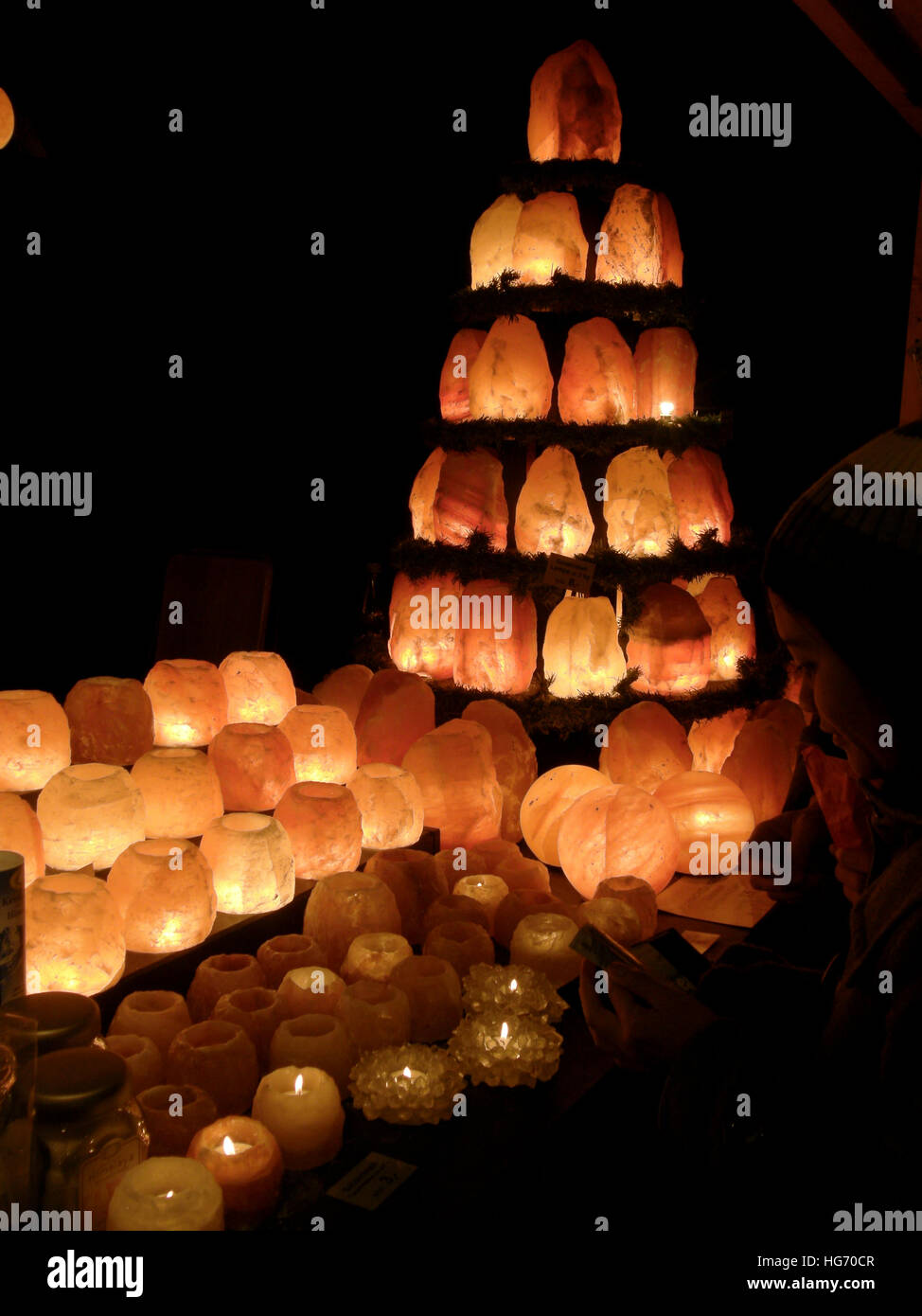 Rock salt candle holders in Berlin Christmas Market - Stock Image