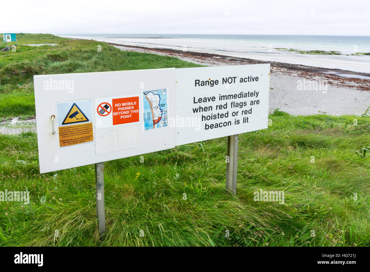 A warning sign at the South Uist missile range operated by Qinetiq in the Outer Hebrides. - Stock Image