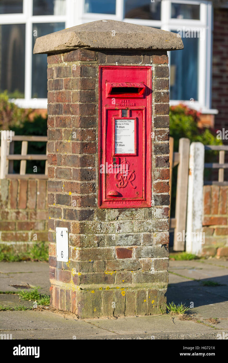 Red Royal Mail wall mounted letter box. Postbox. Mailbox. - Stock Image