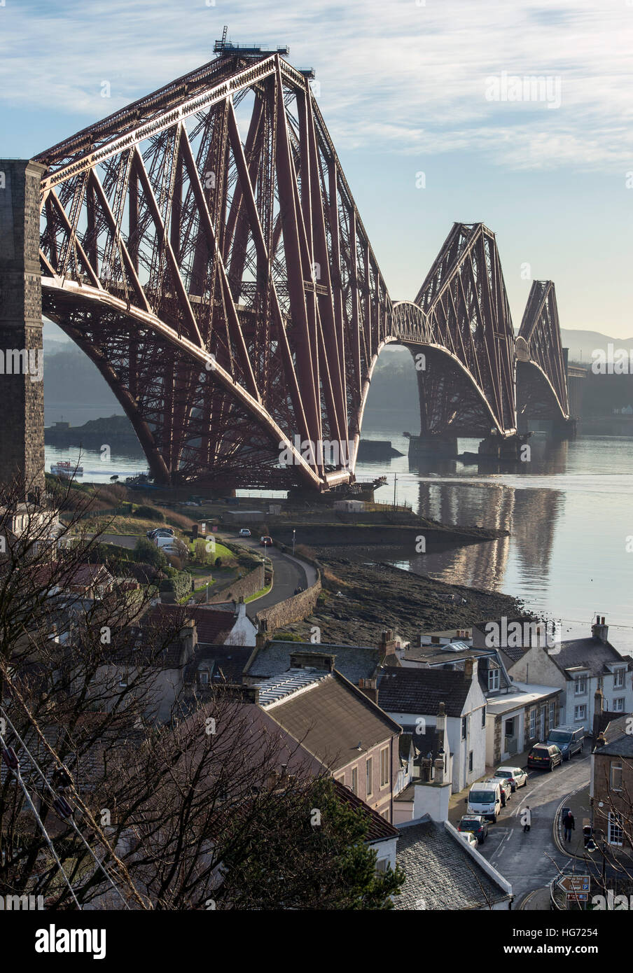 The Forth Rail Bridge viewed from the village of North Queensferry looking south over the Firth of Forth. - Stock Image