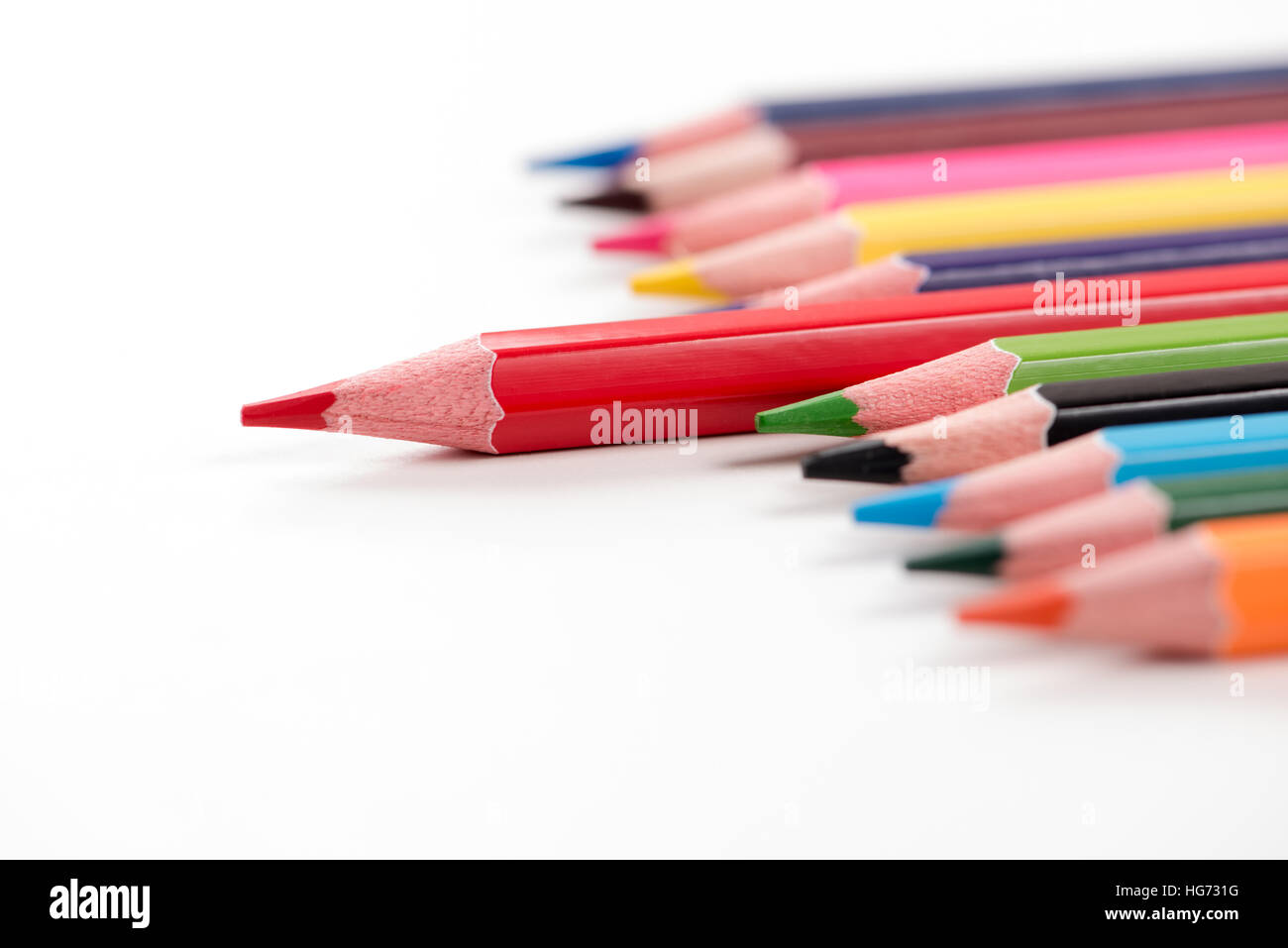 Colored pencils arranged on the table in natural light - Stock Image