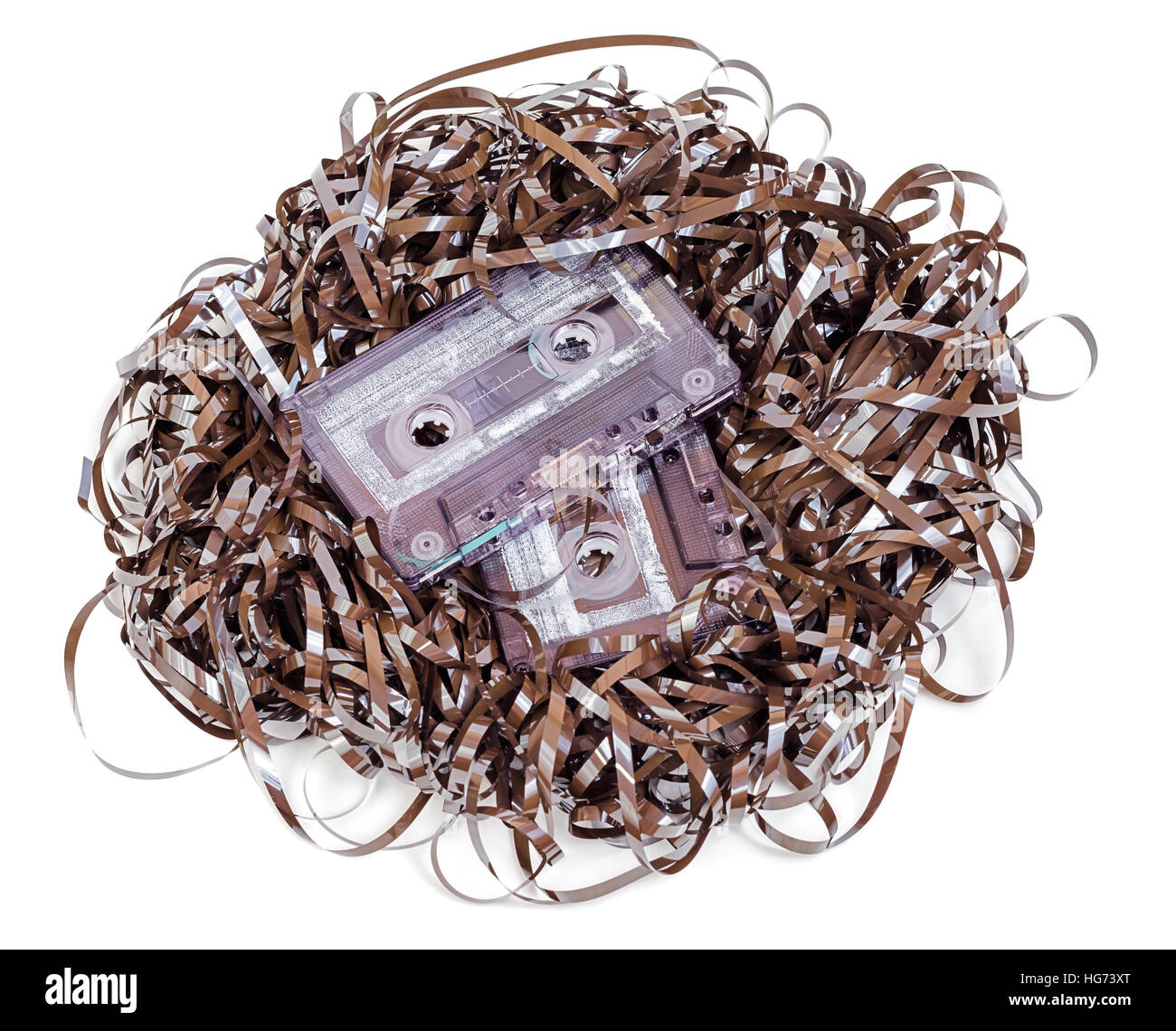 Analog audio cassette with tape tangle isolated on white background - Stock Image