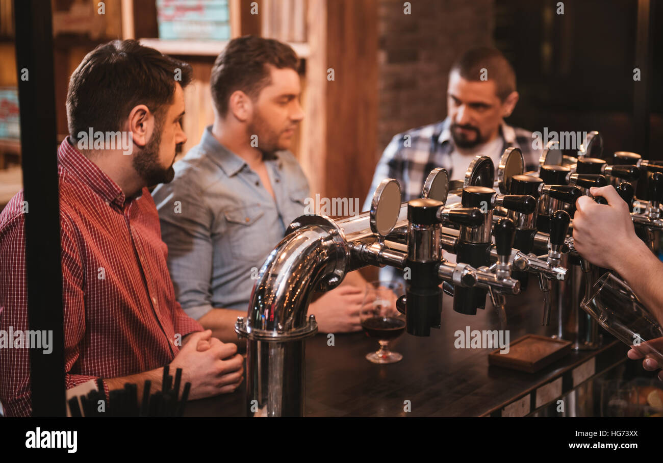 Selective focus of beer taps in the bar - Stock Image