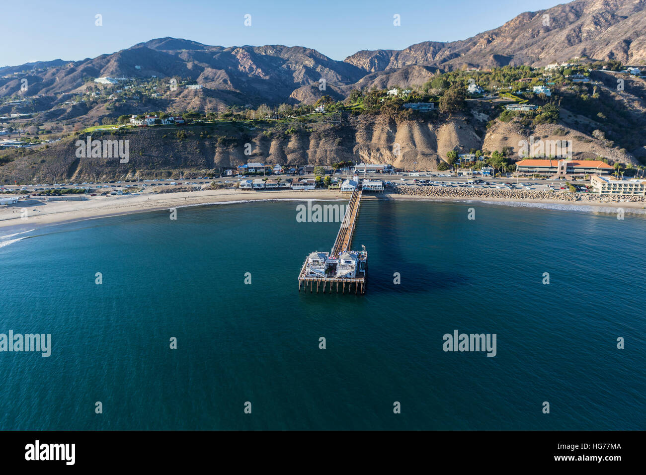 Aerial of Malibu Pier State Park and the Santa Monica Mountains near of Los Angeles California. Stock Photo