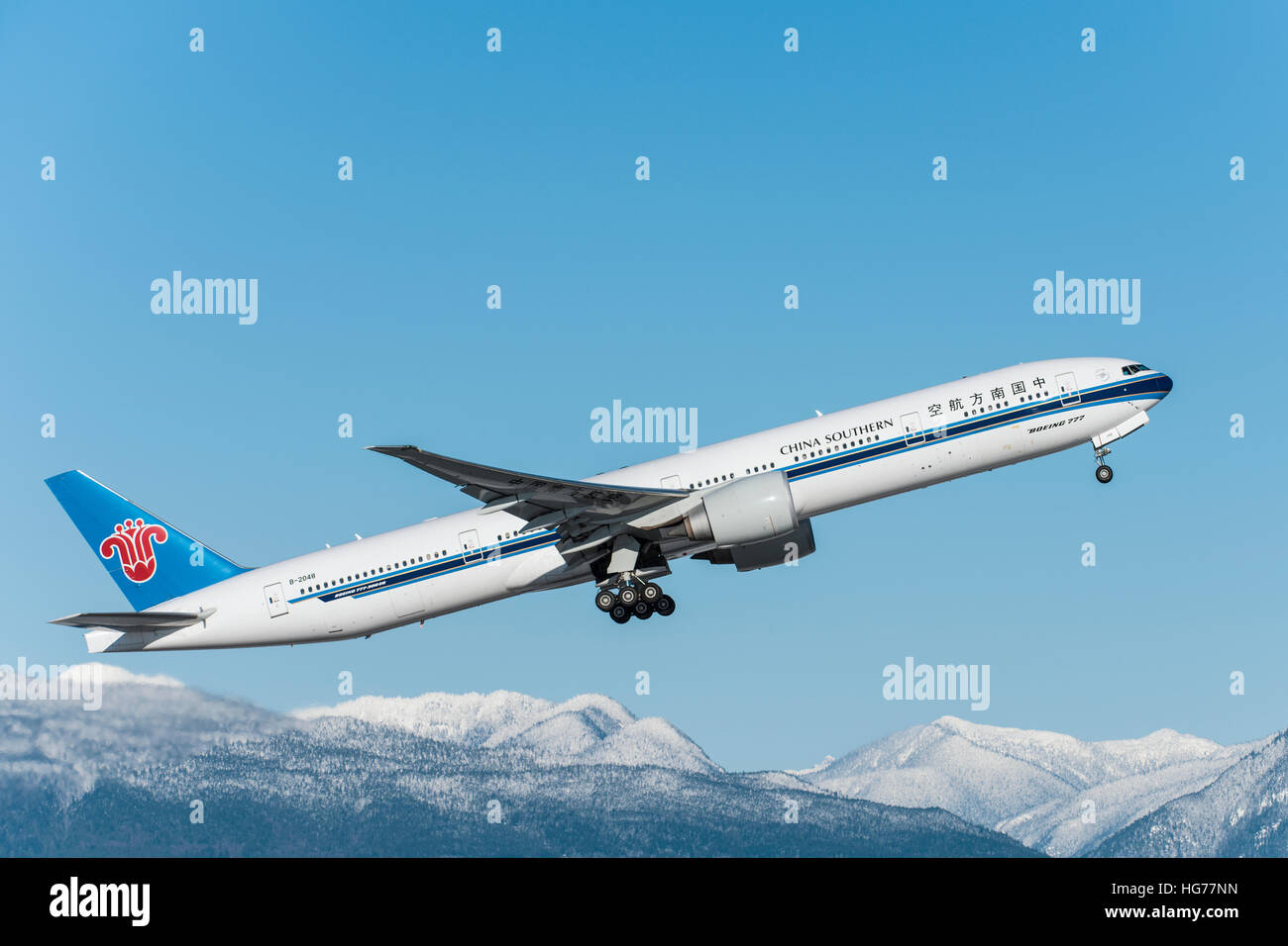 China Southern Boeing 777 airborne after take off from Vancouver International airport. - Stock Image