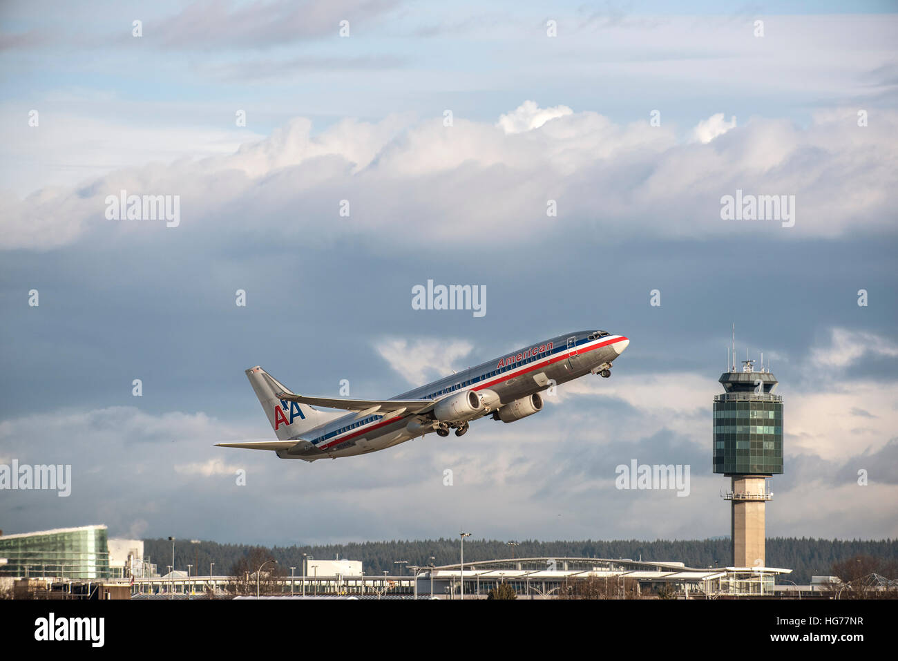 American Airlines Boeing 737-823 airborne after take off from Vancouver International airport. - Stock Image