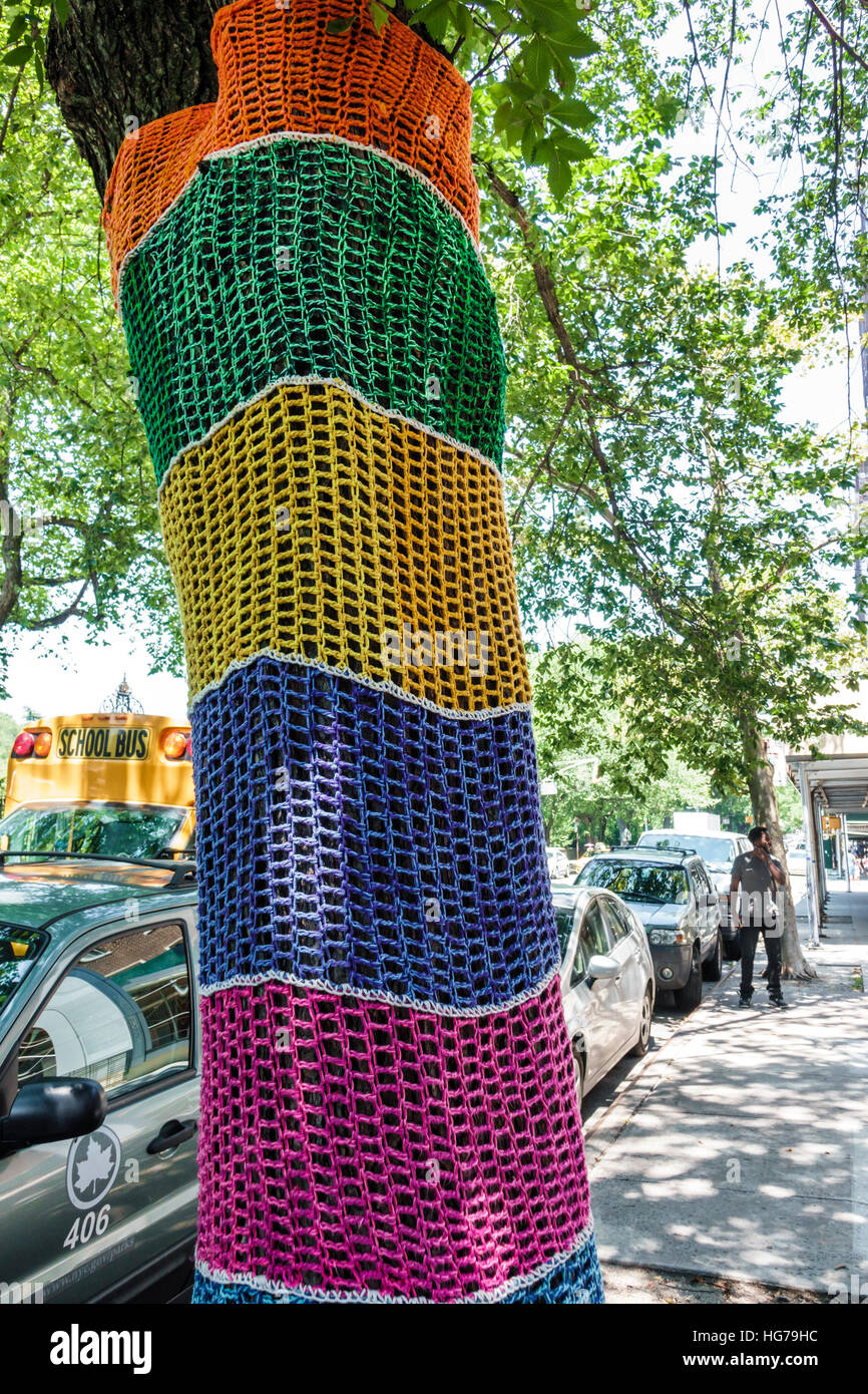 Manhattan New York City NYC NY Spanish Harlem yarn bombing street art crochet cover tree trunk guerrilla crocheting - Stock Image