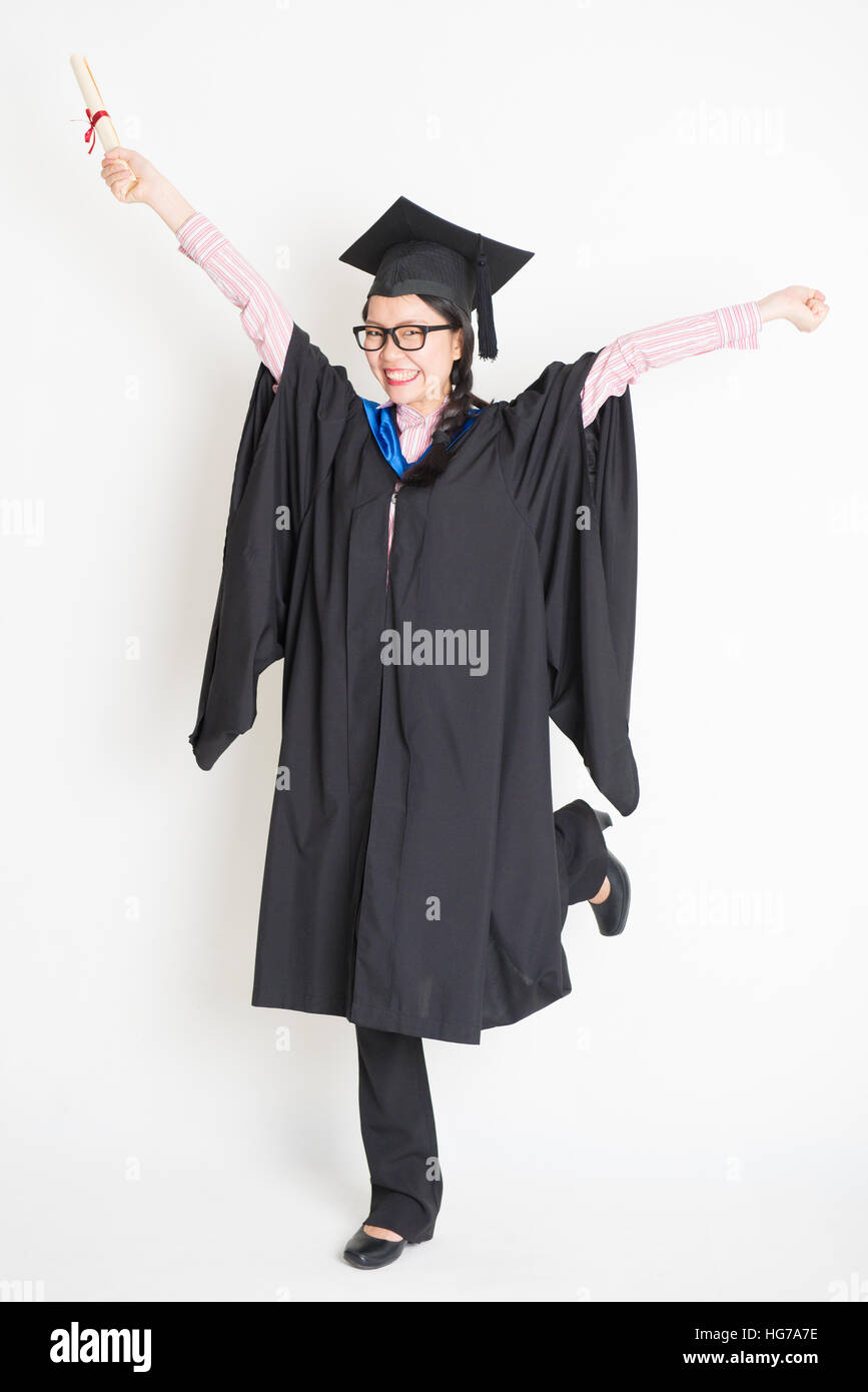 Girl In Graduation Gown Jumping Stock Photos & Girl In Graduation ...