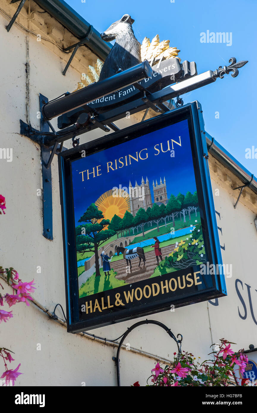 The Rising Sun Public house sign in Wimborne Minster. - Stock Image
