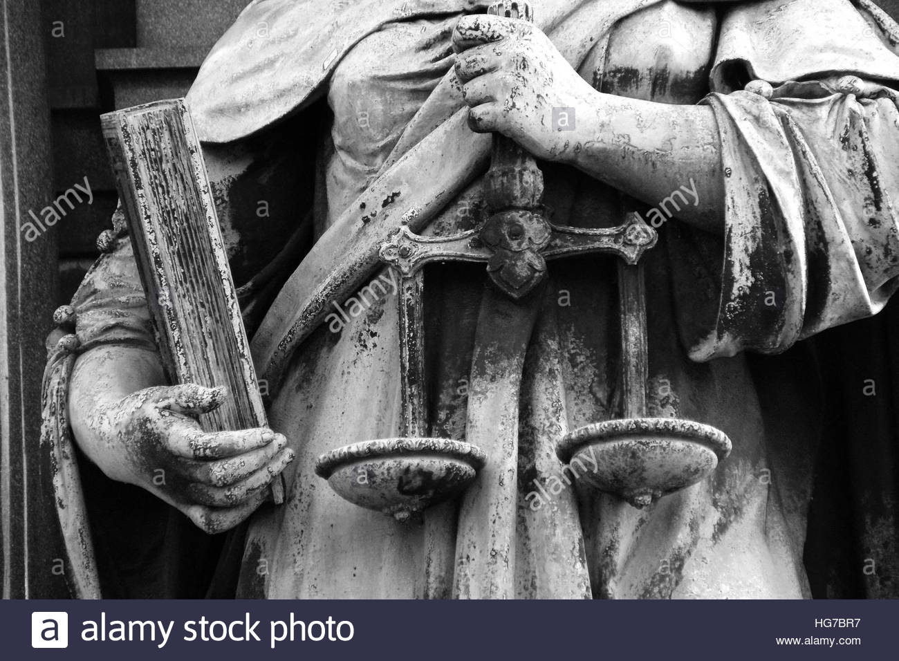 Justitia holds the scales of justice and equality before the law in her hands - Stock Image