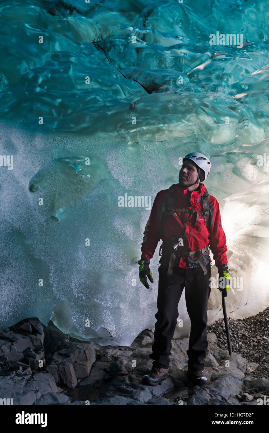 Ice climber in ice cave in South East Iceland in January - Stock Image