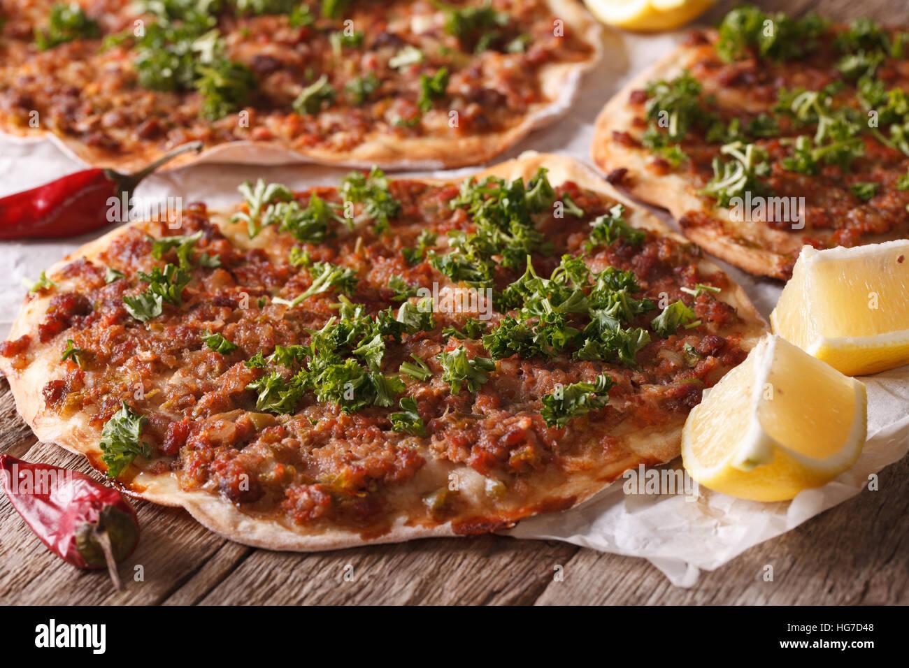 Turkish Food: lahmacun closeup on a wooden table. Horizontal - Stock Image