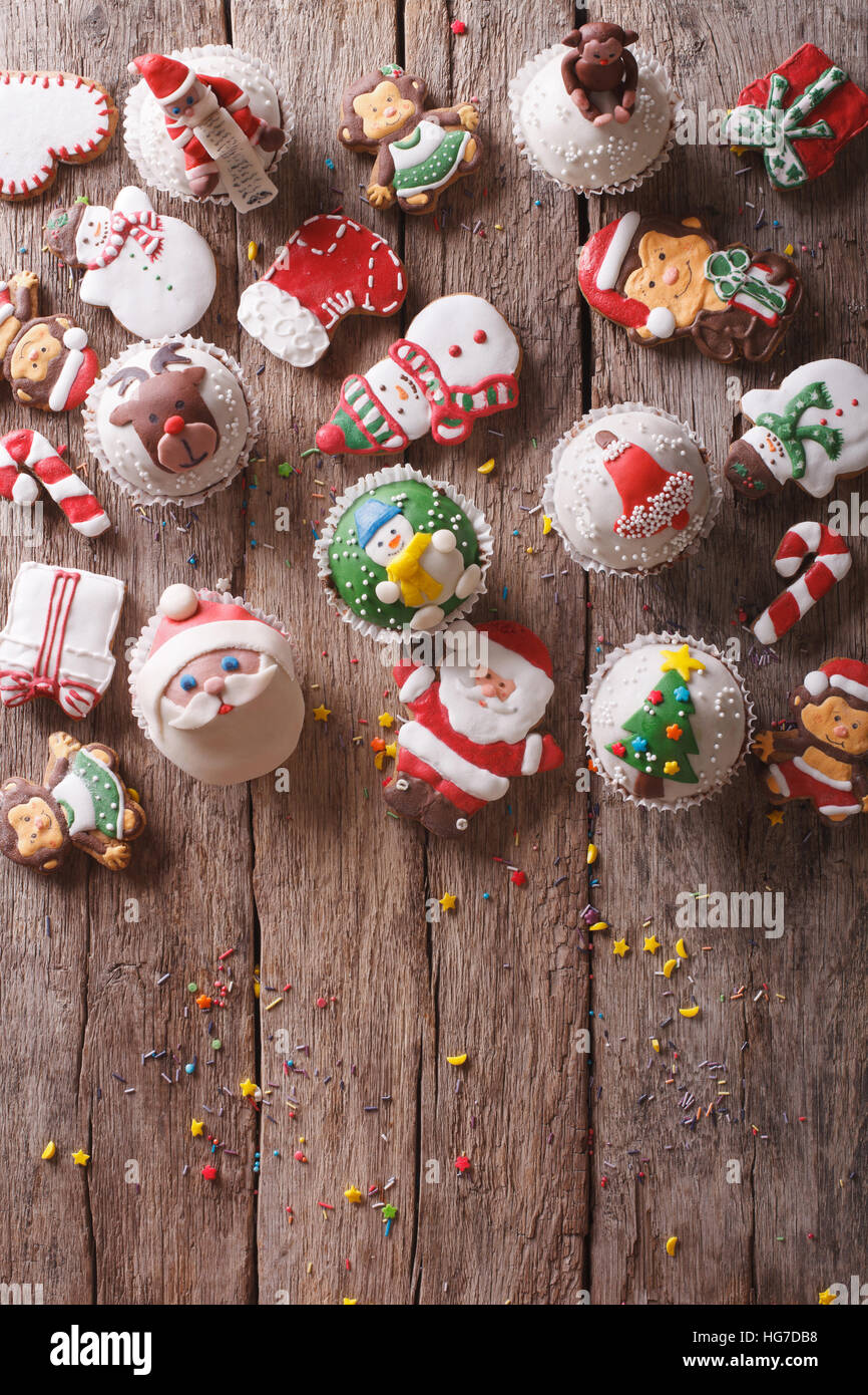 Background of Christmas sweets on a wooden table. vertical top view - Stock Image