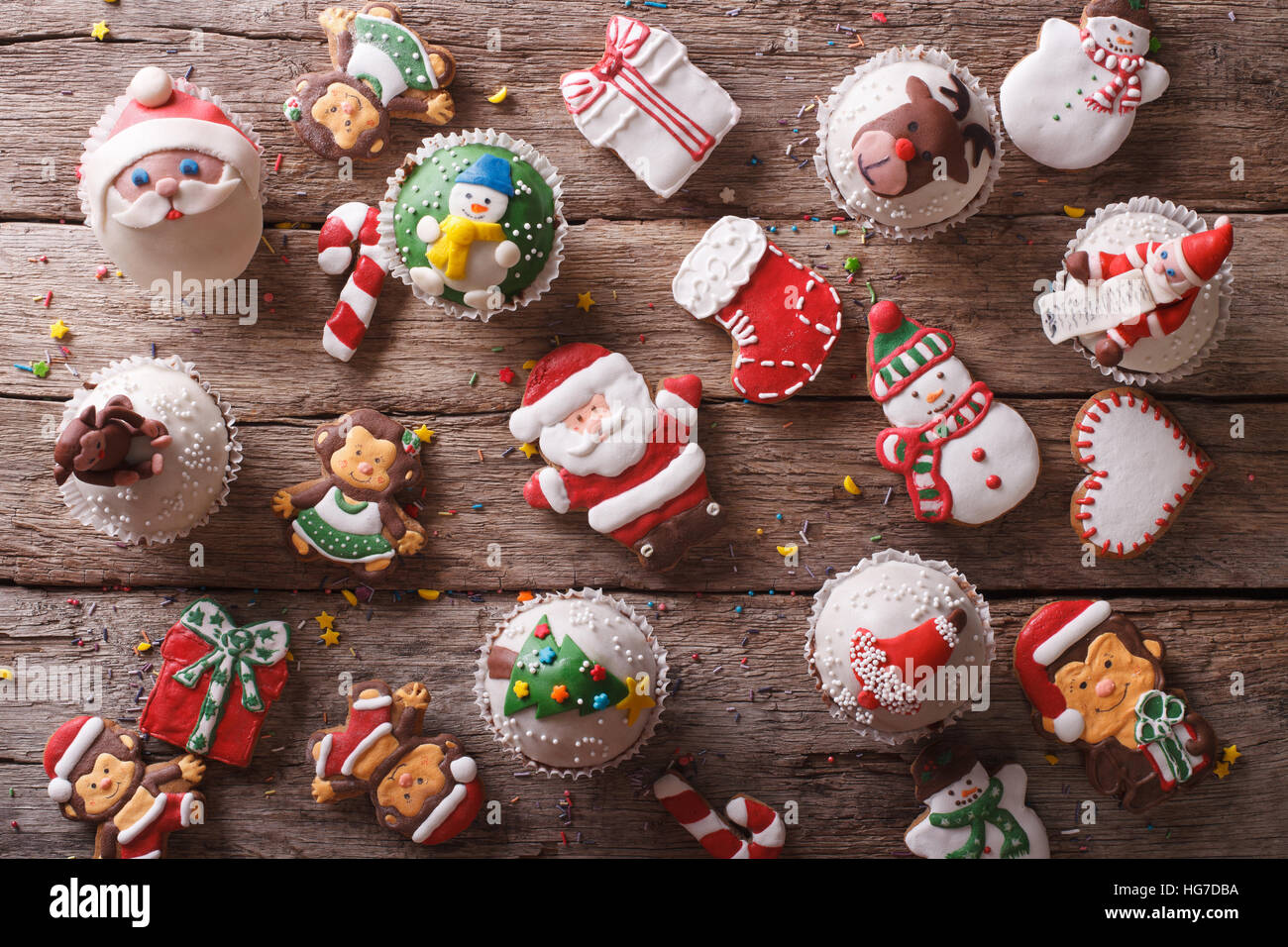 Background of Christmas sweets closeup on a wooden table. horizontal view from above - Stock Image