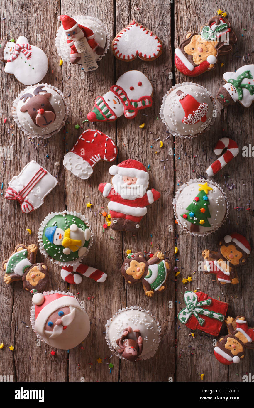 Background of Christmas sweets closeup on a wooden table. vertical top view - Stock Image