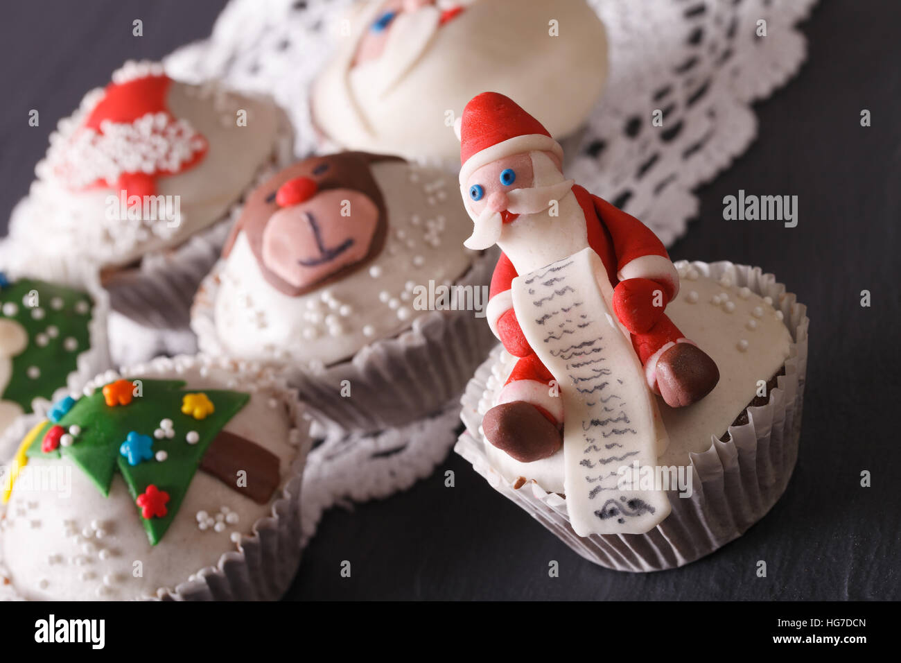 Beautiful delicious cupcakes with Christmas decorations close-up. Horizontal - Stock Image