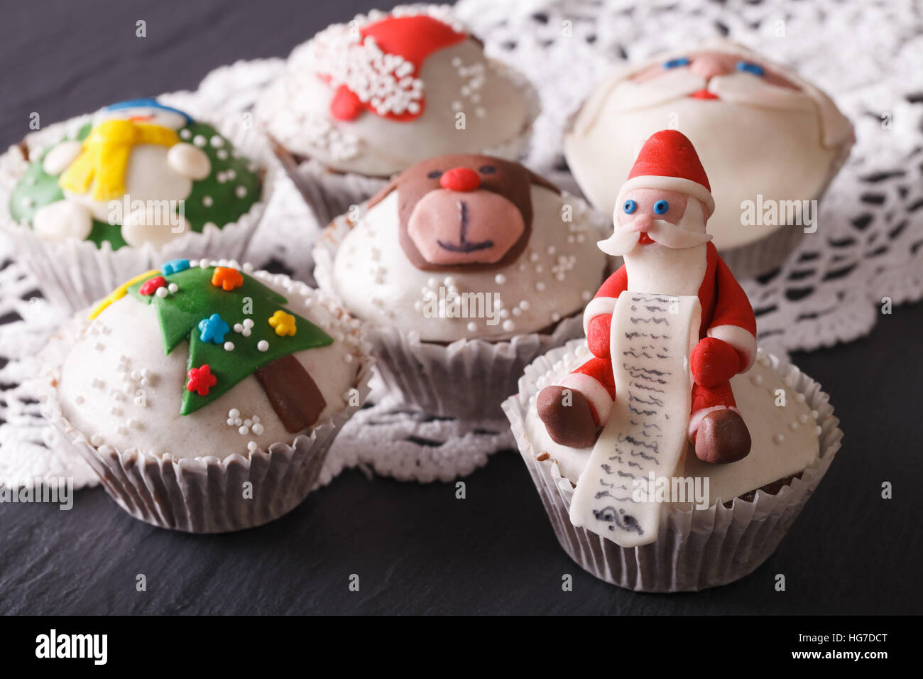 Fabulous Christmas cupcakes decorated  close-up on the table. horizontal - Stock Image