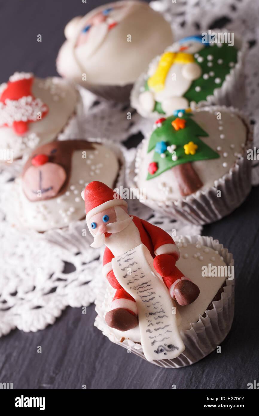Beautiful delicious Christmas cupcakes closeup. vertical - Stock Image