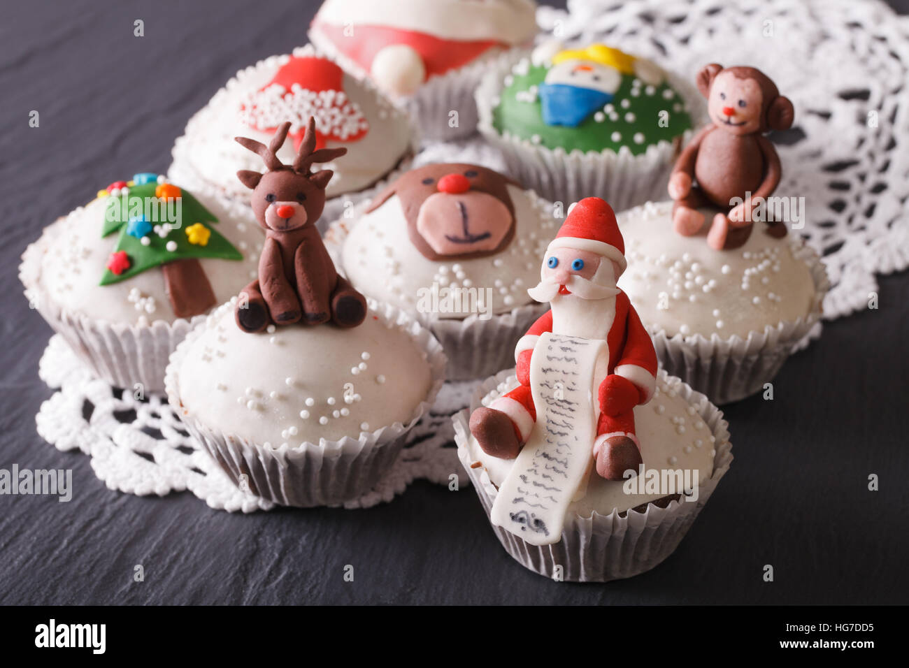 Beautiful Christmas cupcakes decorated fairy-tale figures close-up on the table. horizontal Stock Photo