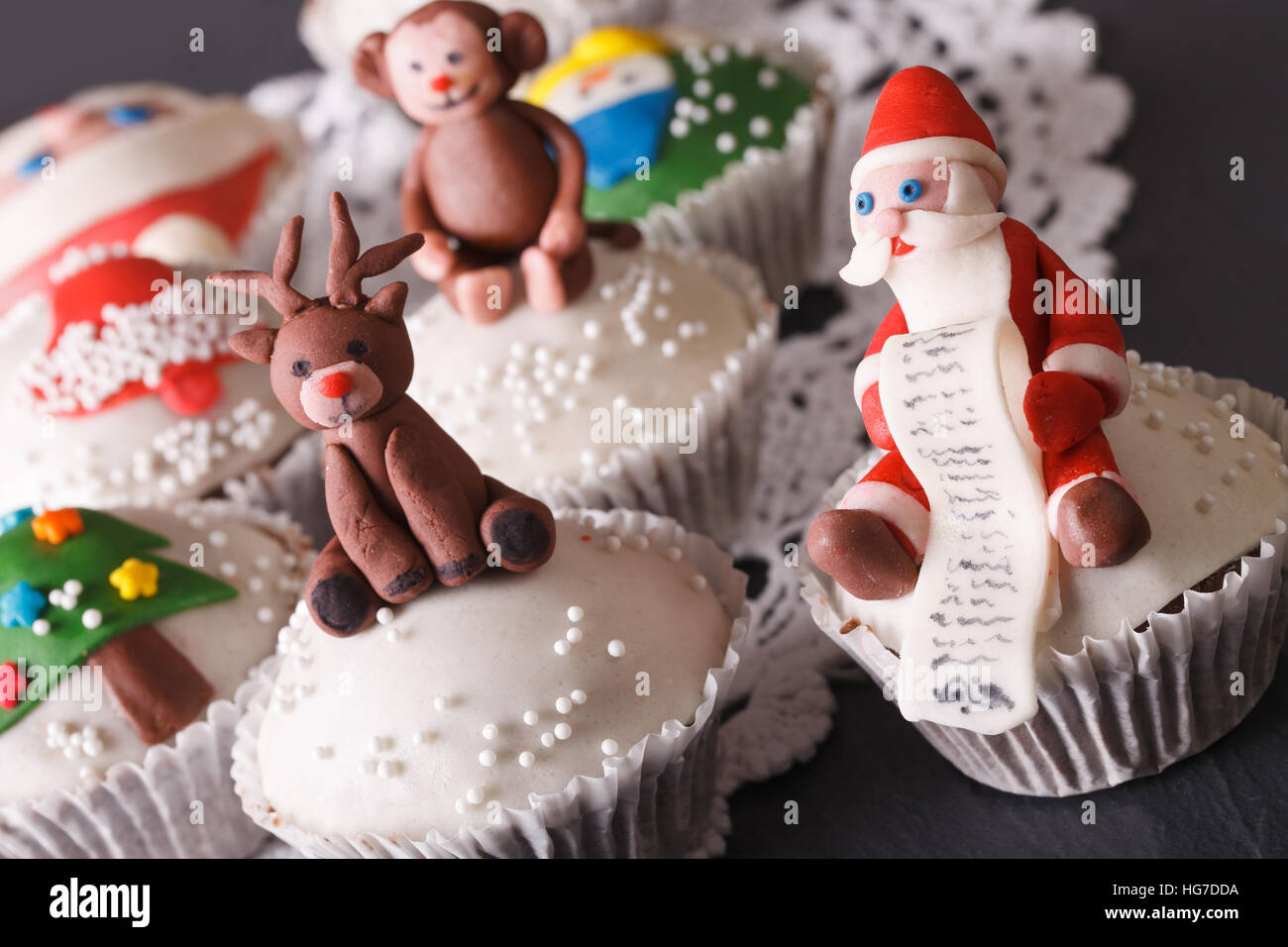 Christmas cupcakes: Santa and reindeer macro on the table. horizontal - Stock Image