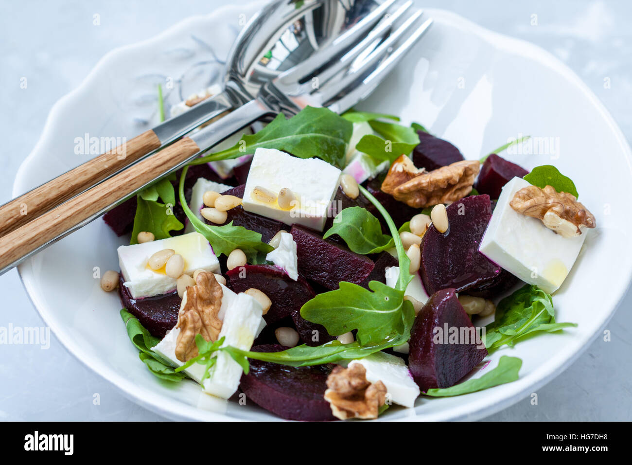 Salad with beets, goat cheese and arugula. - Stock Image