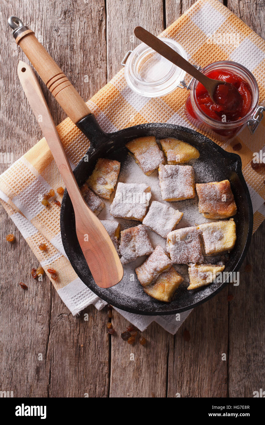 Delicious omelette Kaiserschmarrn with plum sauce on a frying pan. vertical top view Stock Photo
