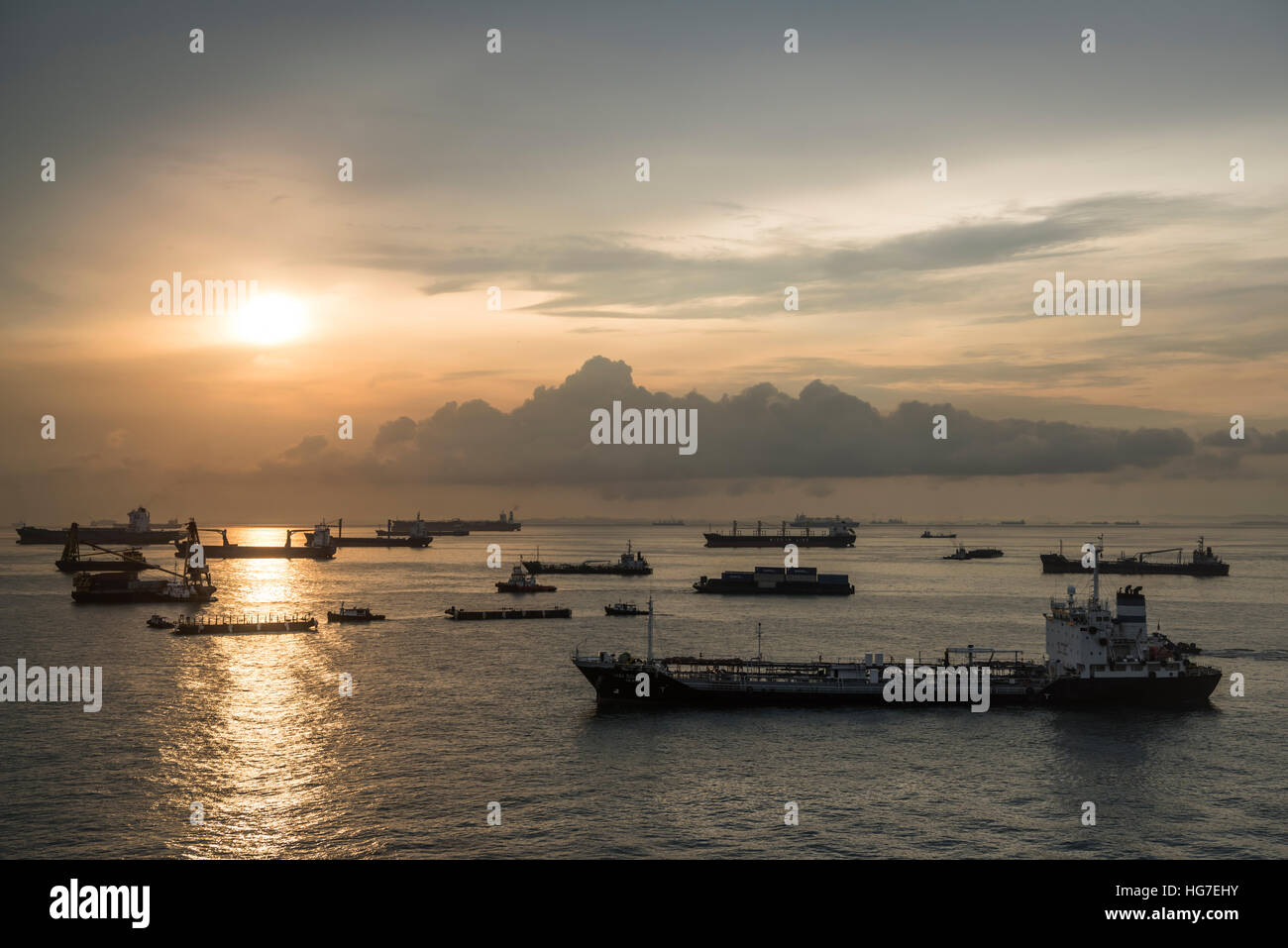 Container and Cargo Vessels in the Busy Singapore Straits at Sunrise - Stock Image