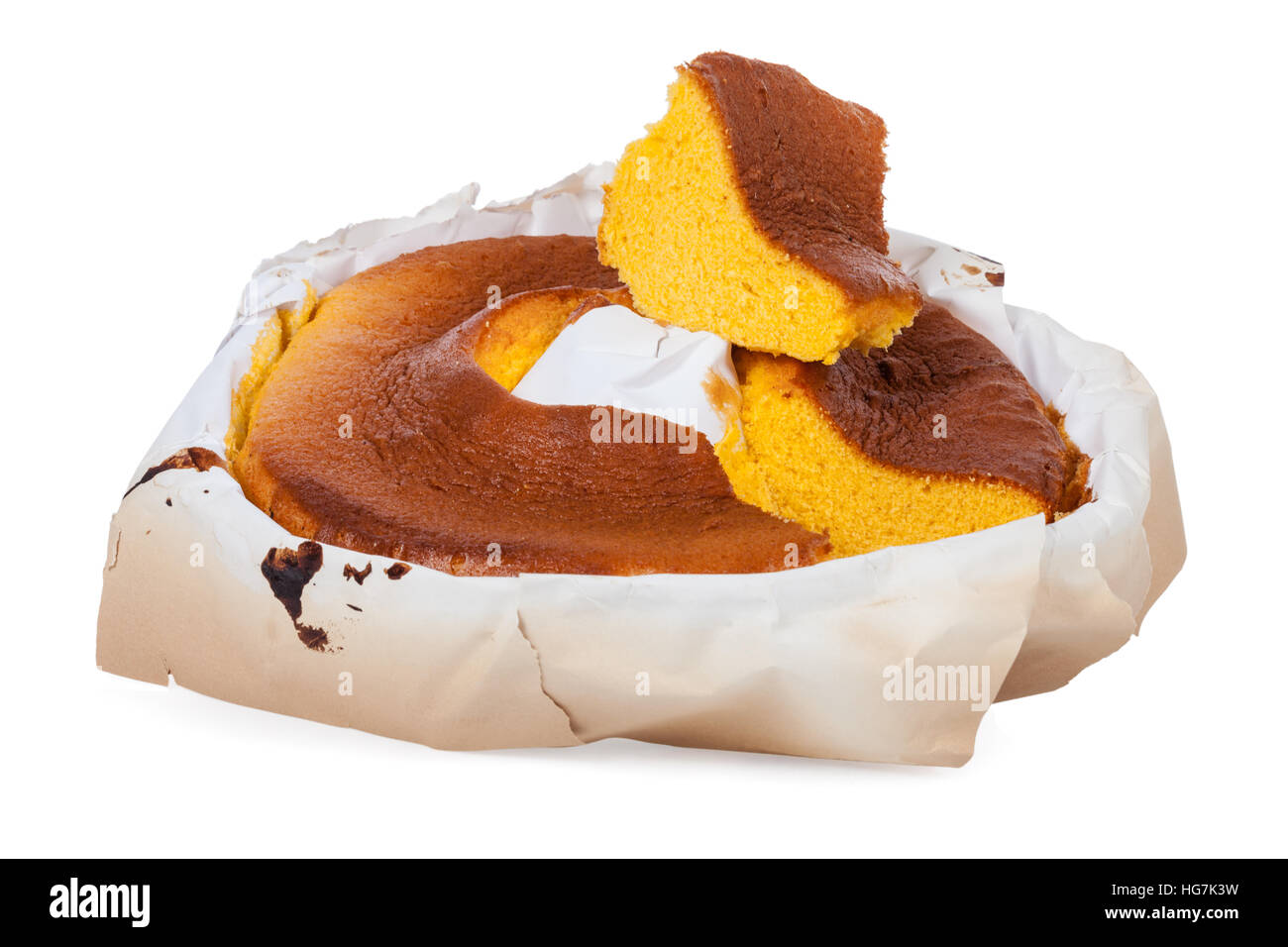 Pao de Lo, the Portuguese sponge cake shown in its most traditional form, with the typical paper sheets used on - Stock Image