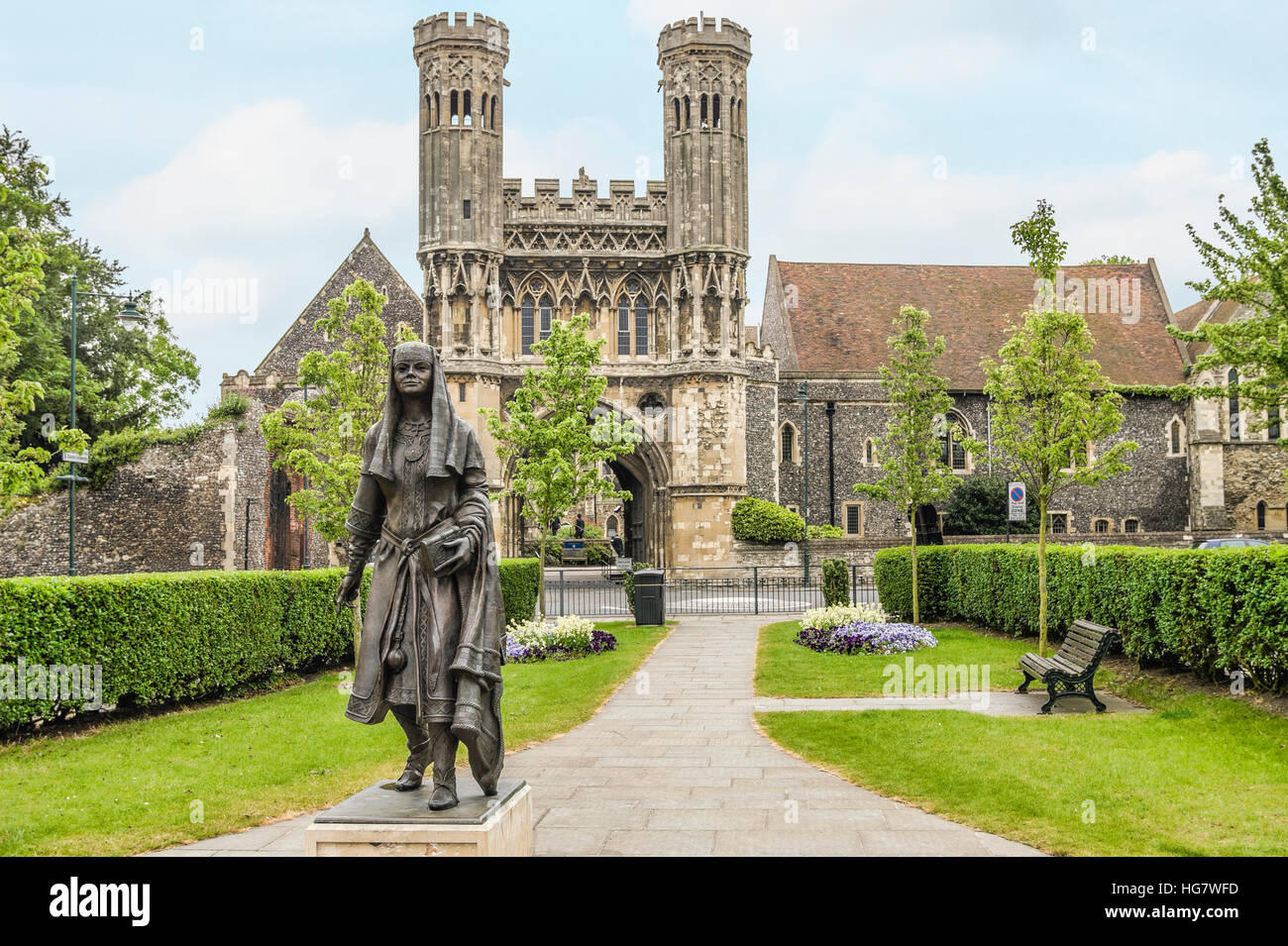 Statue of Bertha, Queen of Kent, princess of the Franks, in front of the entrance gate to Kings School in Canterbury. - Stock Image