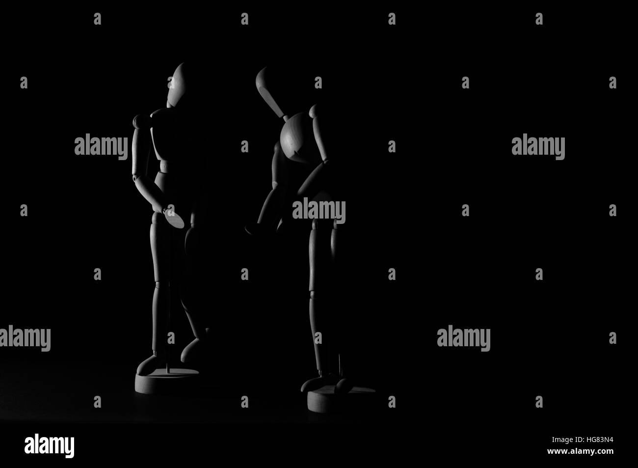 Wooden models on black background - Stock Image