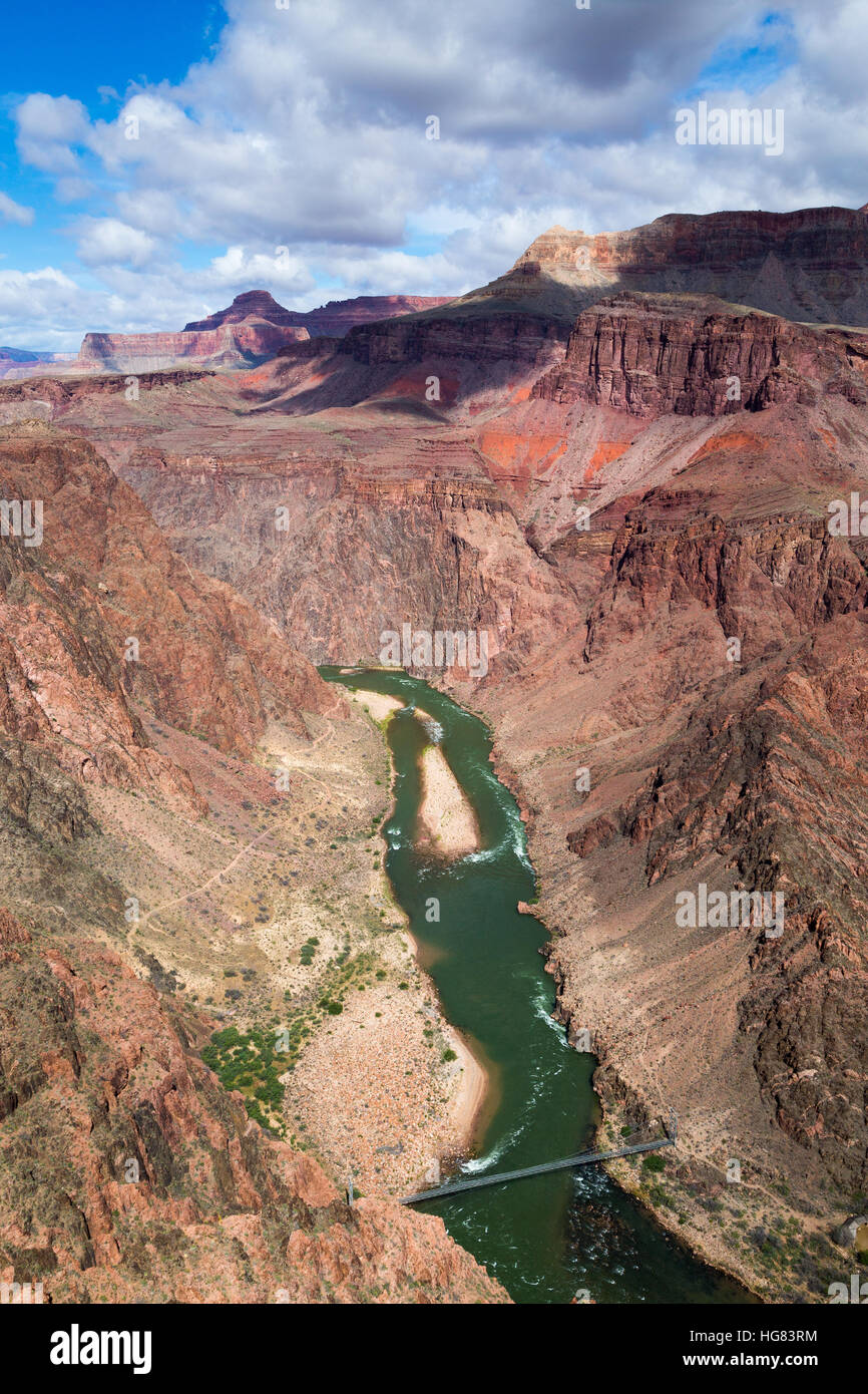The Colorado River flowing through the Grand Canyon below the Silver Suspension Bridge. Grand Canyon National Park, Stock Photo