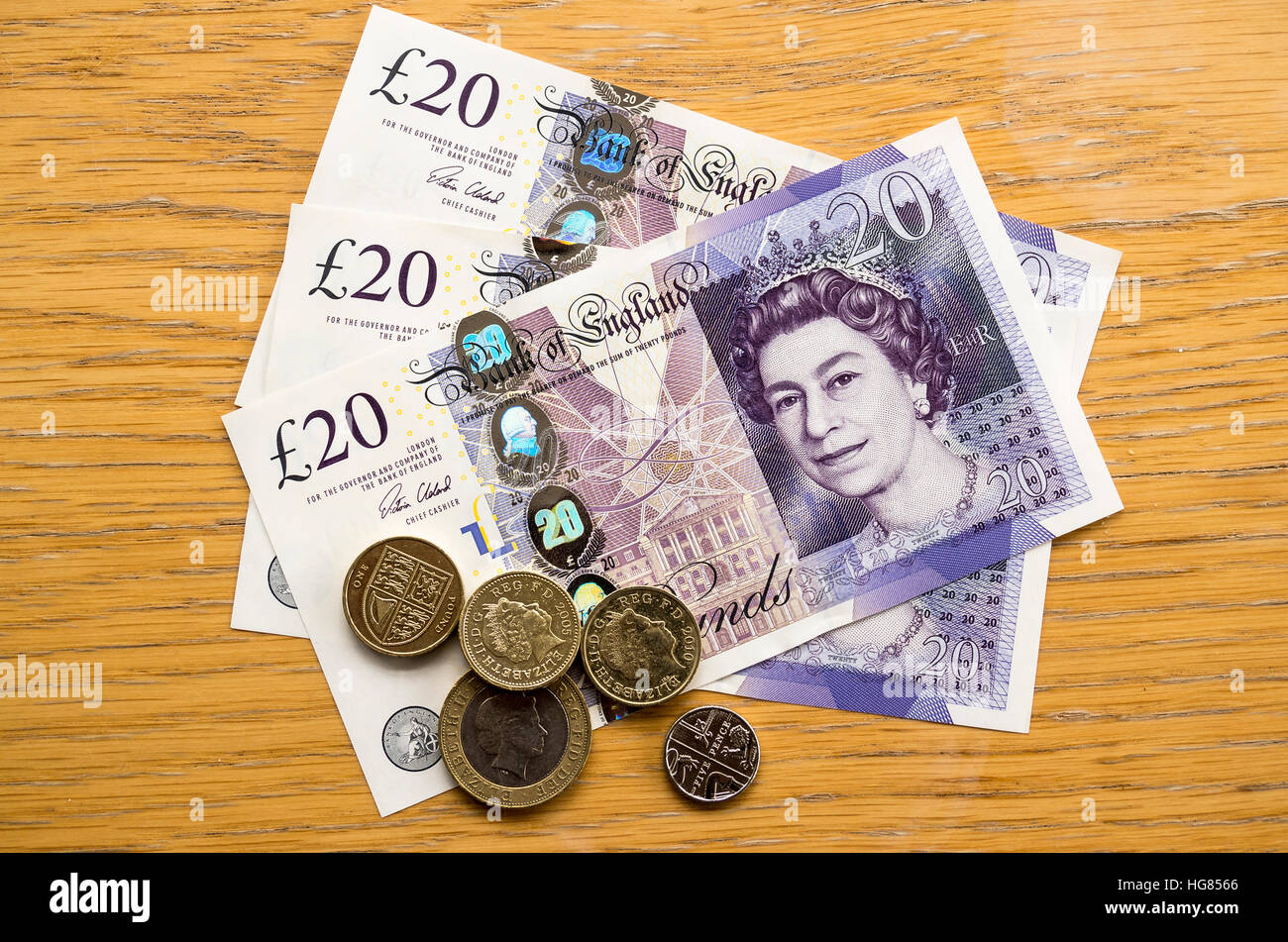 UK British currency notes and coins on a table - Stock Image