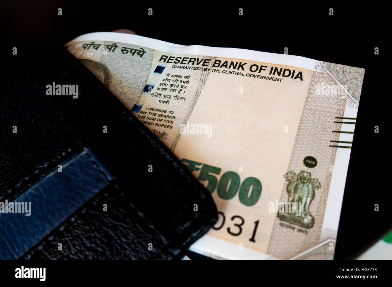 Black leather wallet with new indian currency Stock Photo