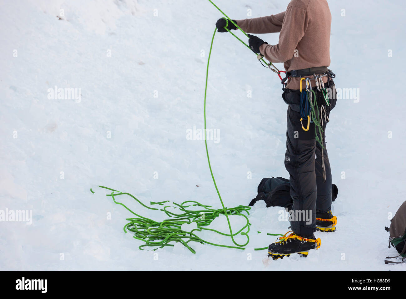 Ouray, Colorado - A climber belays his partner while ice climbing in Ouray Ice Park. - Stock Image