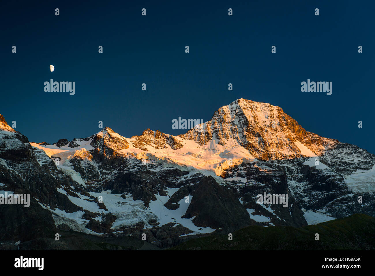 Snow-capped Breithorn with moon at sunset, Lauterbrunnen Valley, Swiss Alps, Jungfrau-Aletsch, Bernese Oberland - Stock Image
