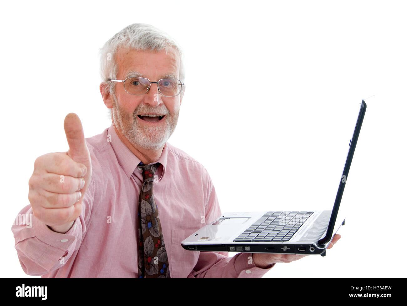 Retiree with laptop - Stock Image