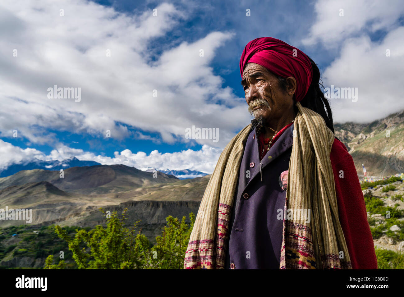 Portrait of Sadhu, holy man, looking into the himalayan mountains, Muktinath, Mustang District, Nepal - Stock Image