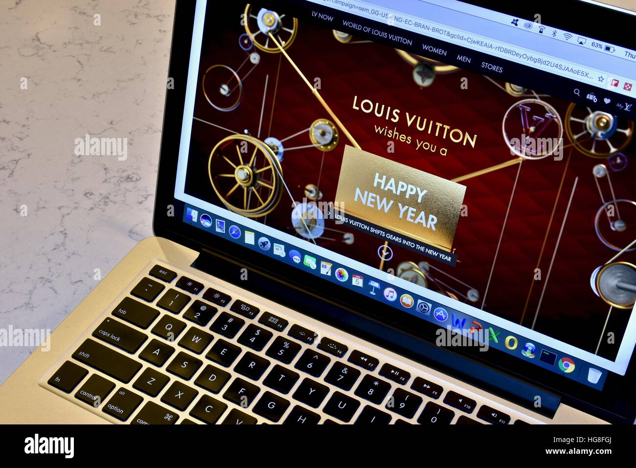71082cac56c3 The Louis Vuitton website displayed on an Apple Macbook Pro Stock ...