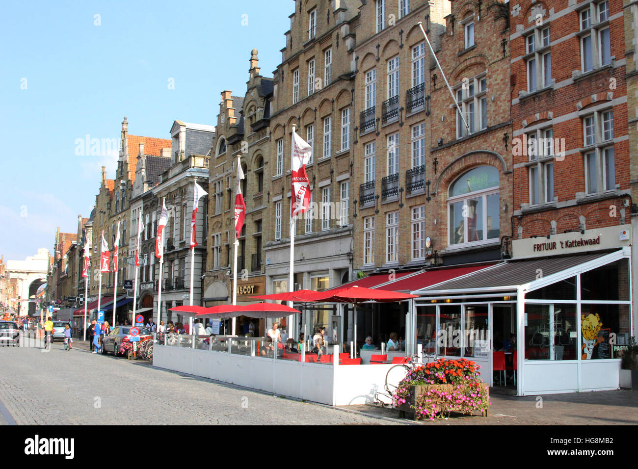 Cafes line the Grote Markt, in Ypres, Ieper Belgium. All the building are reconstructions after previous destruction Stock Photo