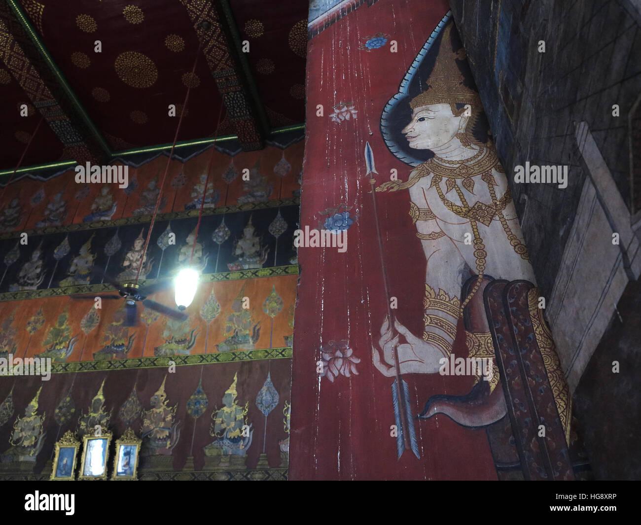 Wall painting inside the prayer hall of  Wat Rakhang Khositaram, Bangkok. - Stock Image