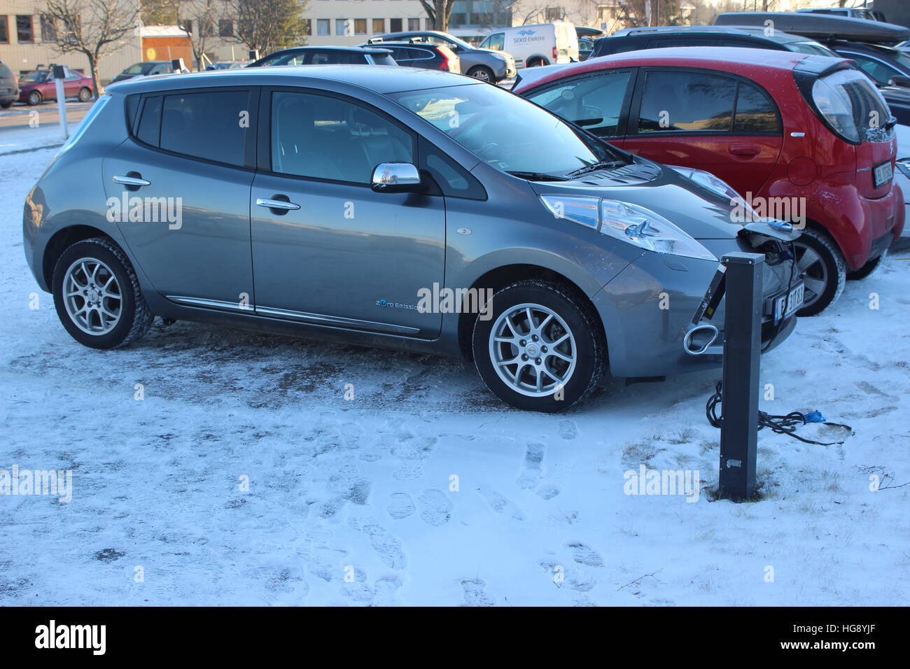 Electric cars charging in the cold weather in Norway Stock Photo