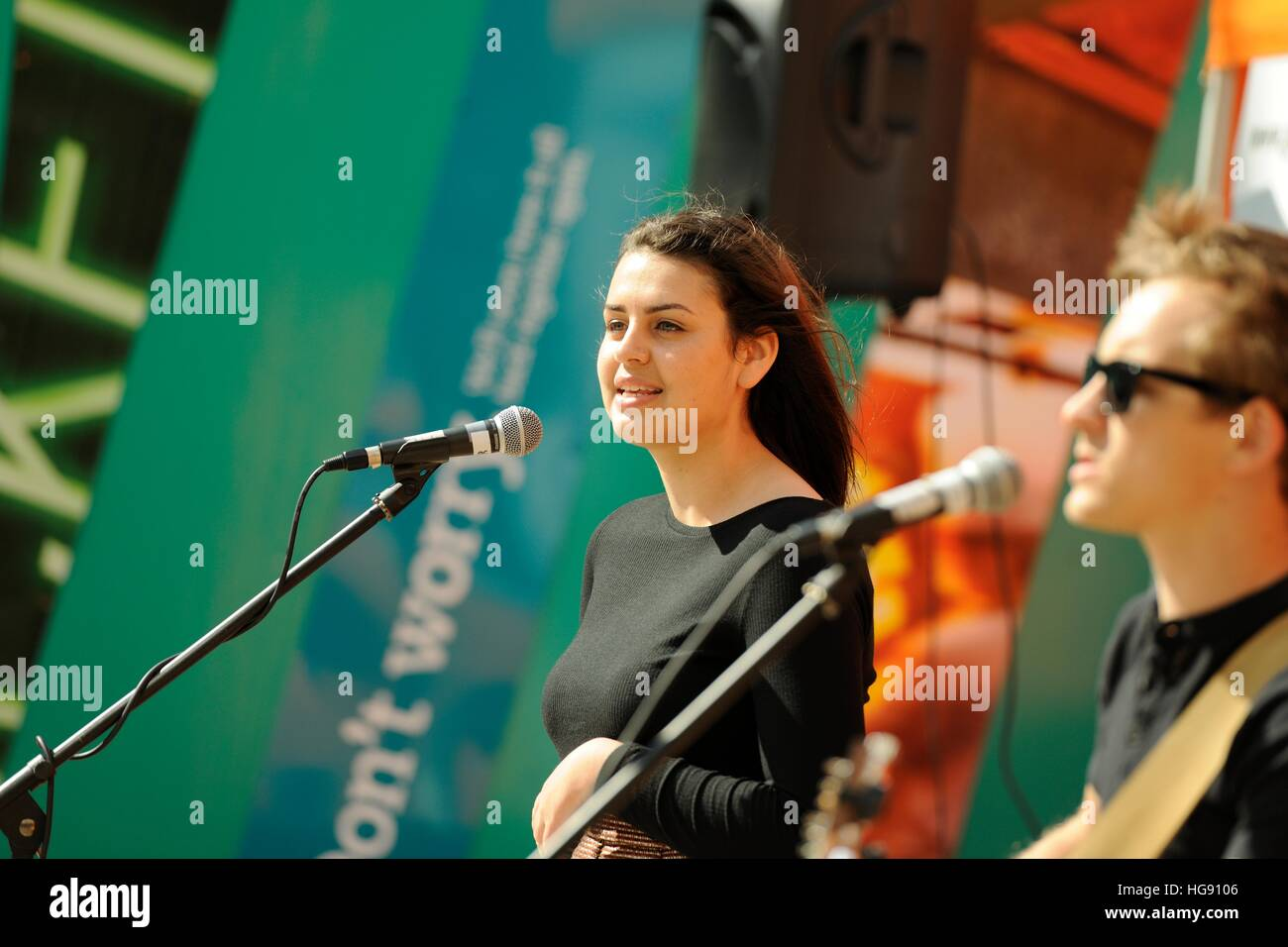 Female singer and male guitarist performing at Tramlines Festival Fringe on The Moor  Sheffield 2014 - Stock Image