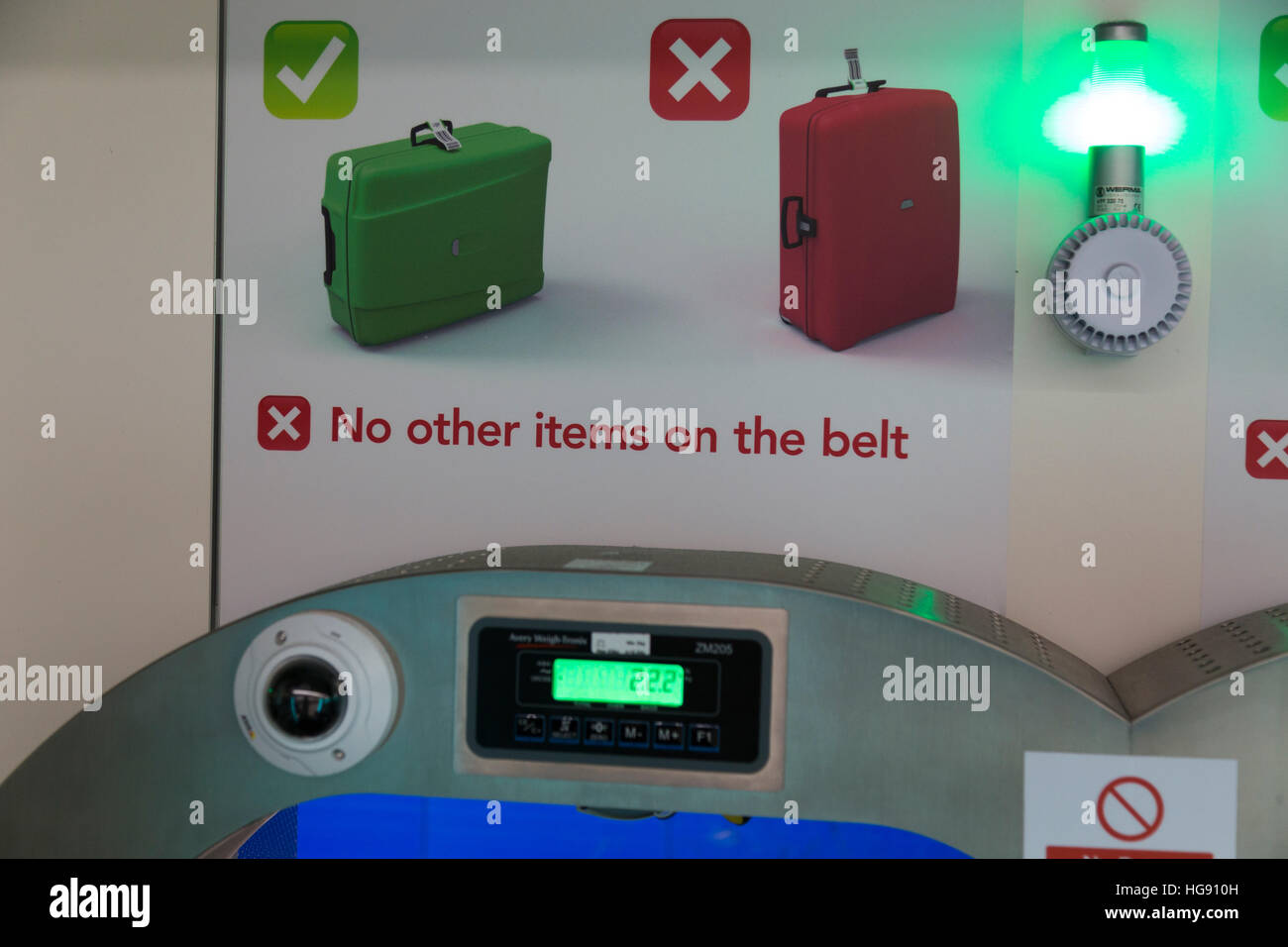 Airport check in KG weighing scale / scales display to weigh passenger bags baggage / luggage weight checked into - Stock Image