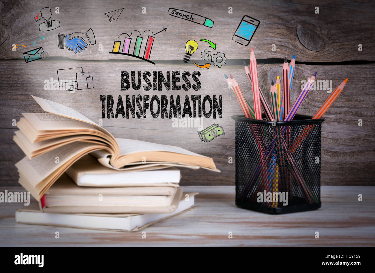 Business Transformation. Stack of books and pencils on the wooden table. - Stock Image