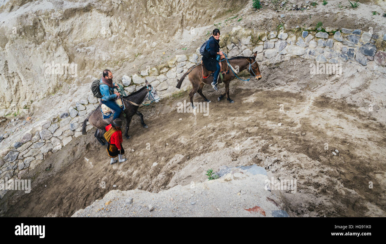 Horse riders on the trail around the Quilotoa, Volcano - Stock Image