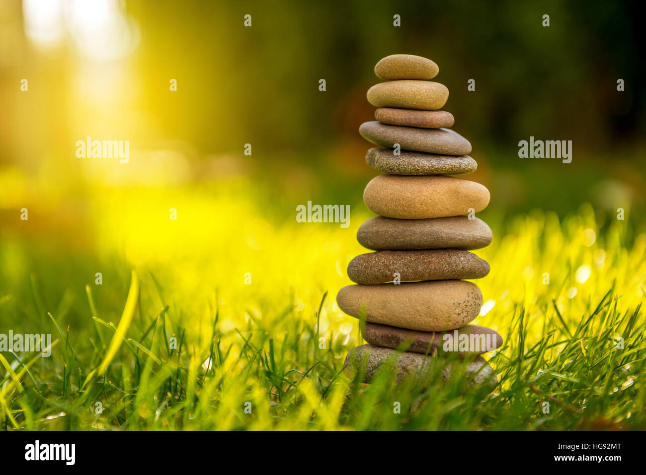 Stones Balance in sunset at sea in april - Stock Image