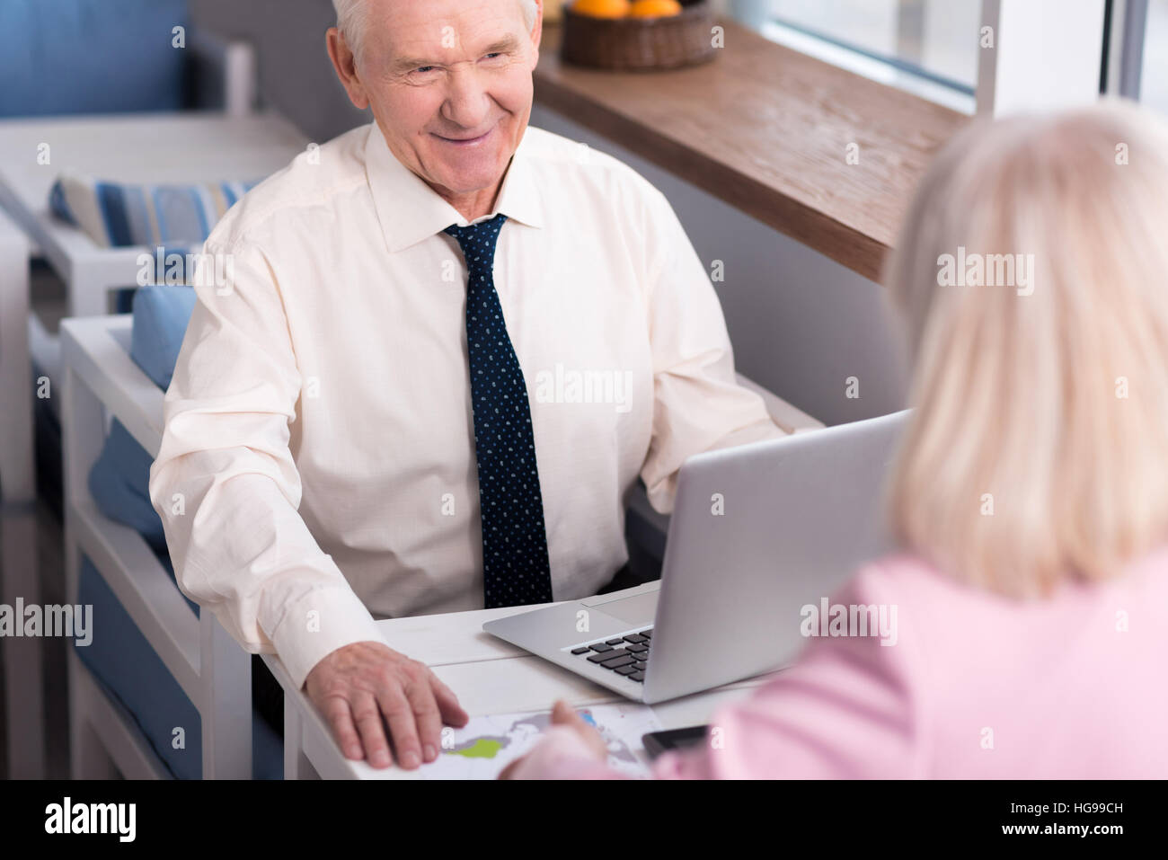 Pleasant executive talking to his partner - Stock Image