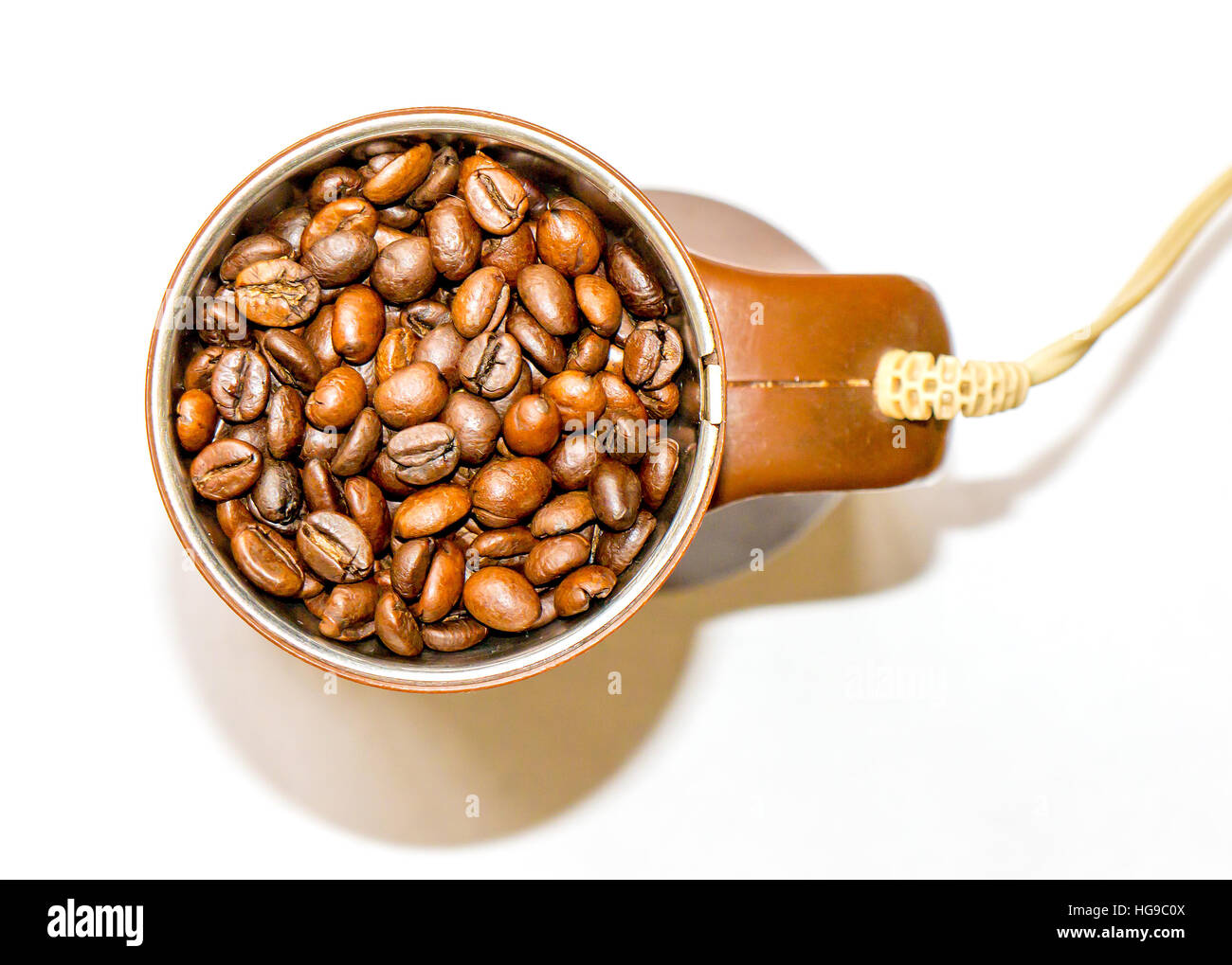 The brown coffee mill isolated. - Stock Image