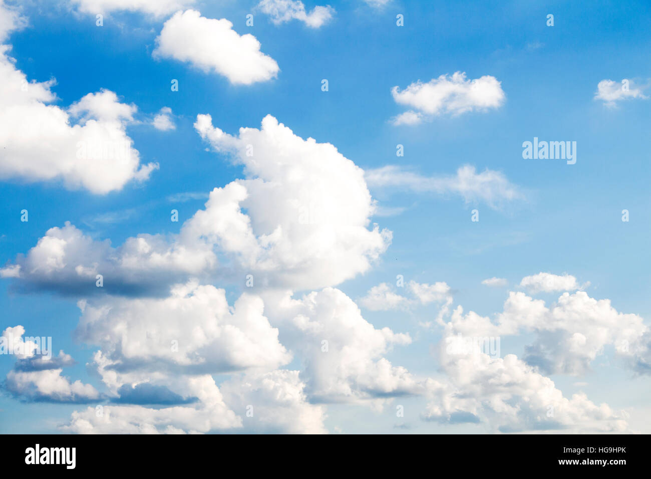 White Fluffy clouds on clear blue sky - Stock Image