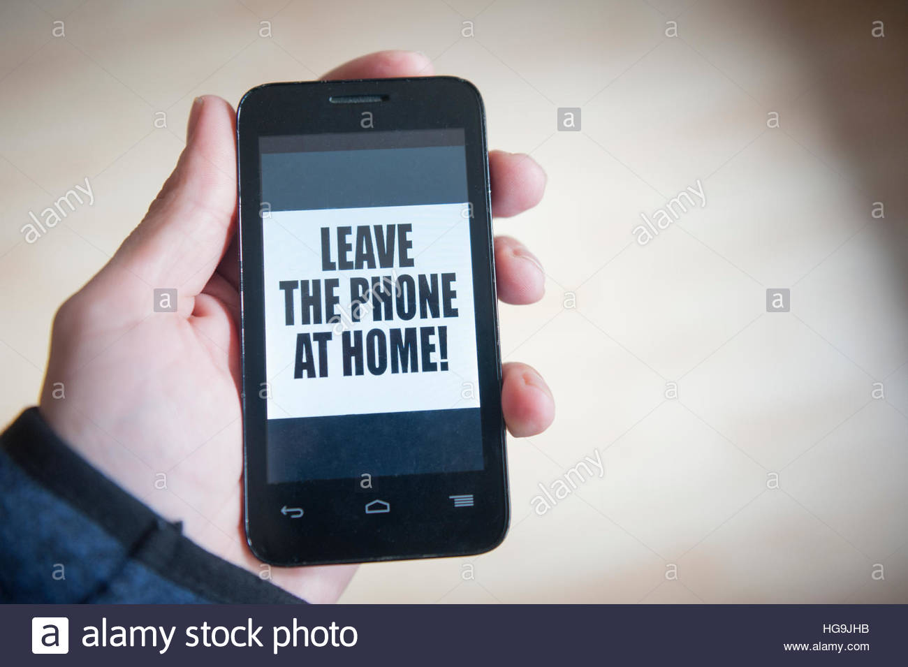 Concept - Mobile telephone addiction - Leave the phone at home! - Stock Image